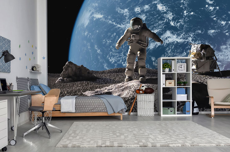cool astronaut wallpaper in boy's trendy bedroom