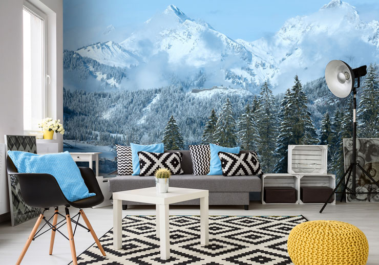 snow capped mountains and blue sky wallpaper in open plan living room