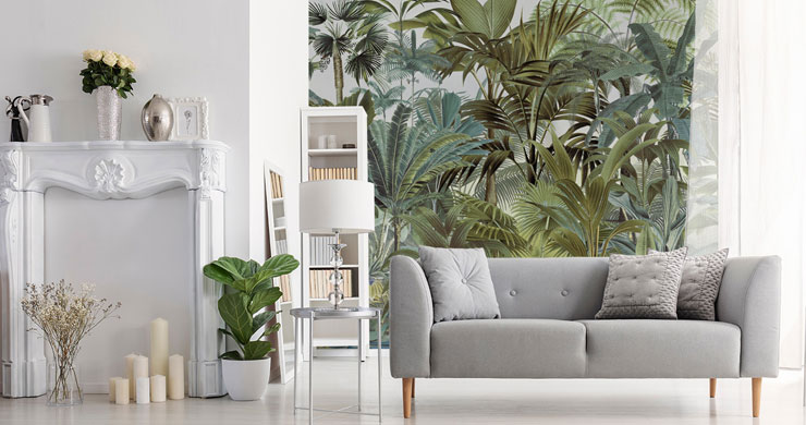 illustrated leafy jungle wall mural in stylish open plan lounge