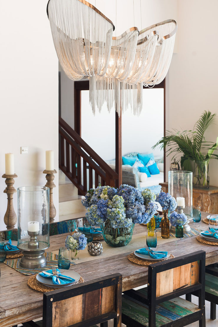 beautiful flowing crystal chandelier in blue themed dining room