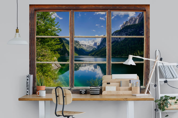lake and mountain window view in cool, white home office