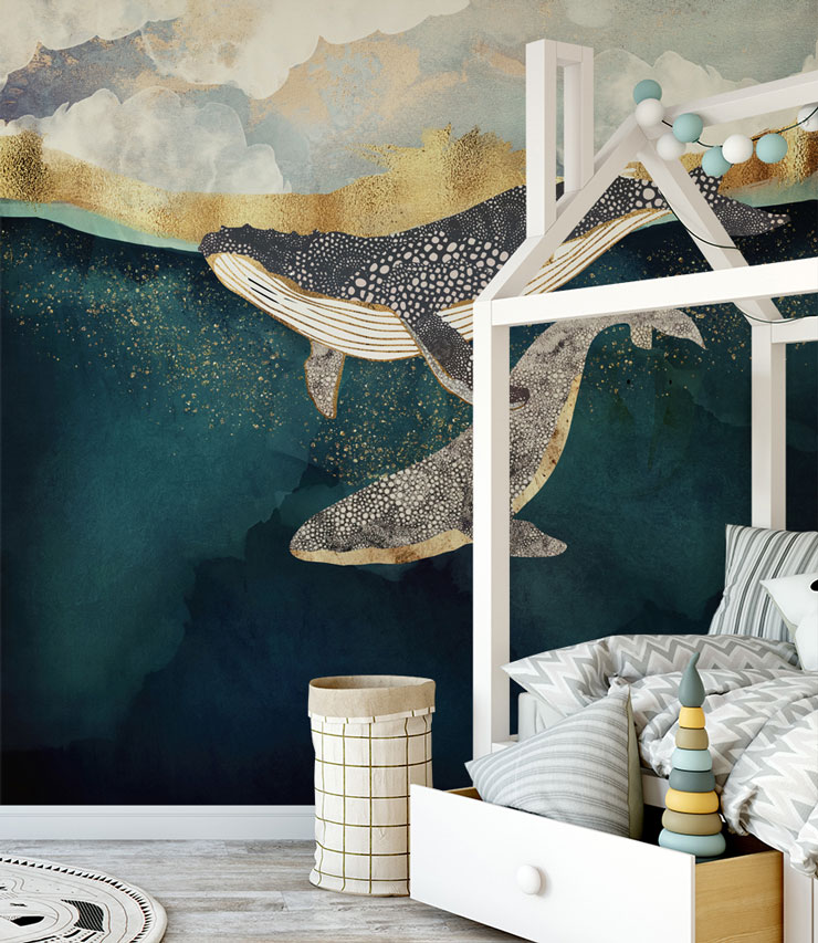 whales swimming in abstract navy and gold effect wallpaper in child's nursery
