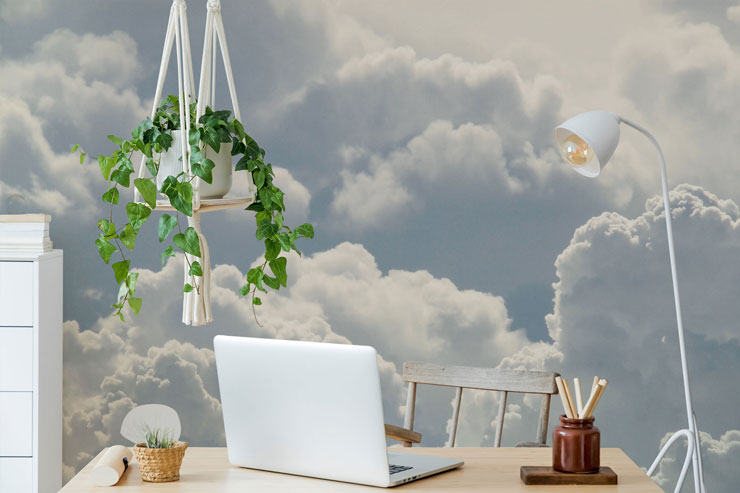 white fluffy clouds wall mural in trendy white office