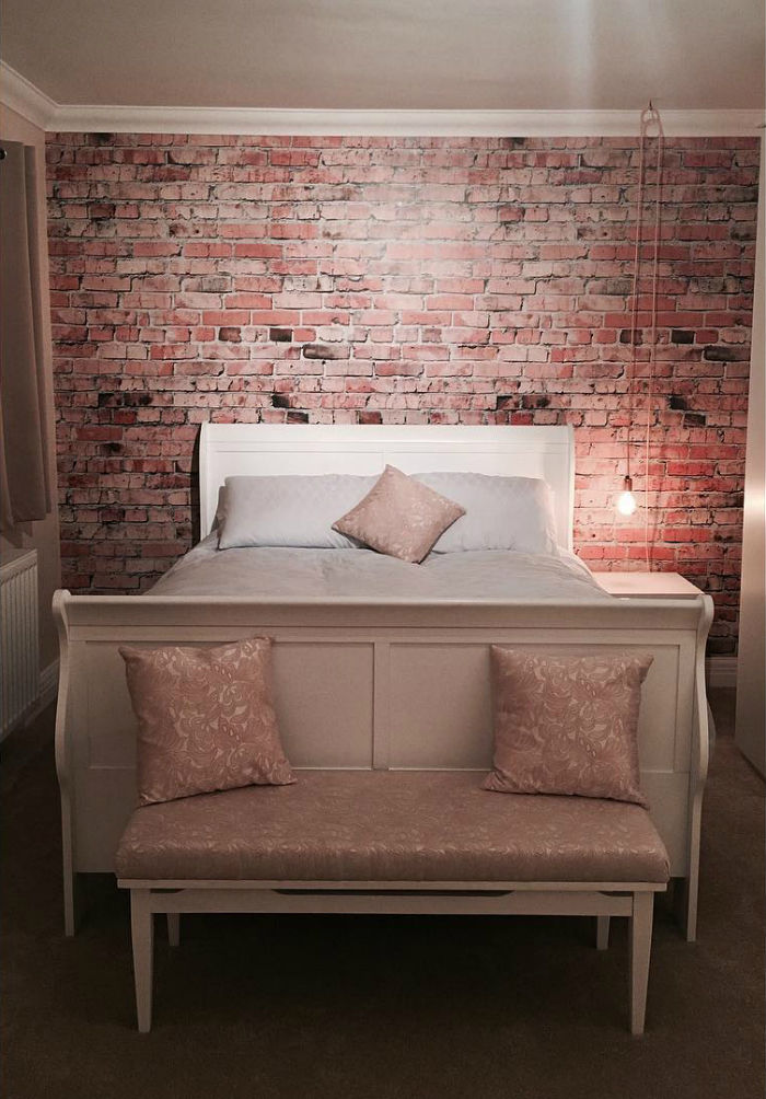 Brick wall trend in bedroom achieved with a Wallsauce wall mural