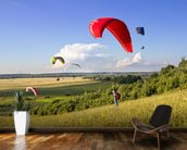 Multiple paragliders soar in the air amid wondrous landscape wallpaper mural kitchen preview