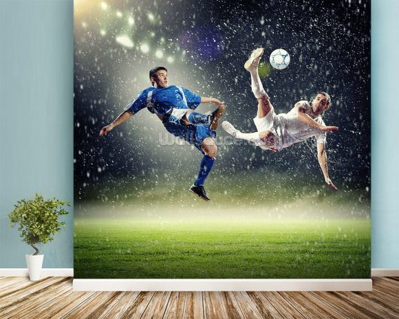 Two football players striking the ball wallpaper mural room setting