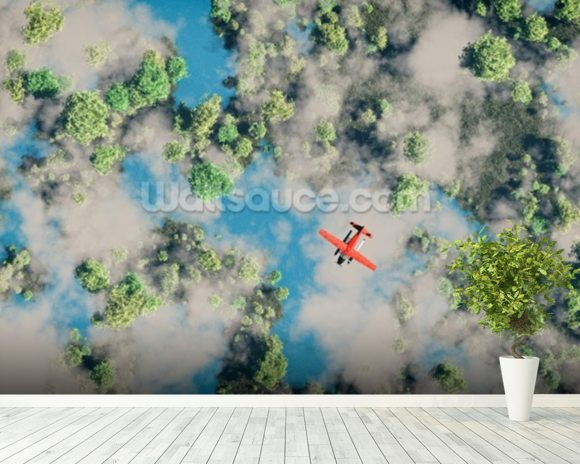 Aerial of red airplane flying over forest wall mural room setting