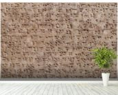 Ancient Assyrian clay tablet with cuneiform writing wallpaper mural in-room view
