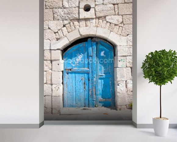 Wooden blue door in Madaba mural wallpaper room setting