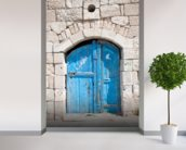 Wooden blue door in Madaba mural wallpaper in-room view