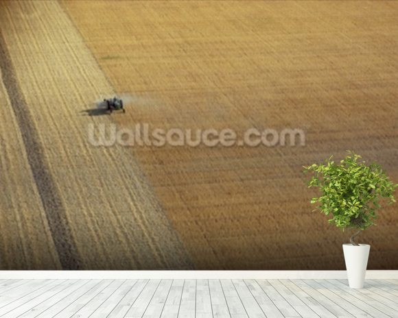 A tractor harvesting (photo) mural wallpaper room setting