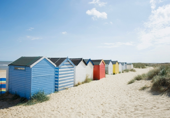 Brightly Coloured Beach Huts mural wallpaper