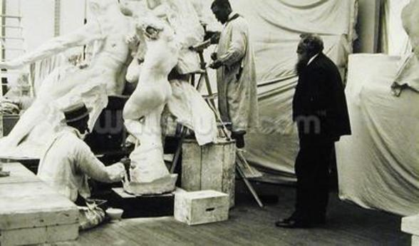 Auguste Rodin (1840-1917) in his Paris studio watching the construction of a sculpture, 1905 (b/w photo) wall mural