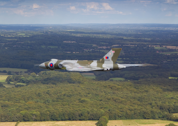 Avro Vulcan Bomber over countryside wallpaper mural