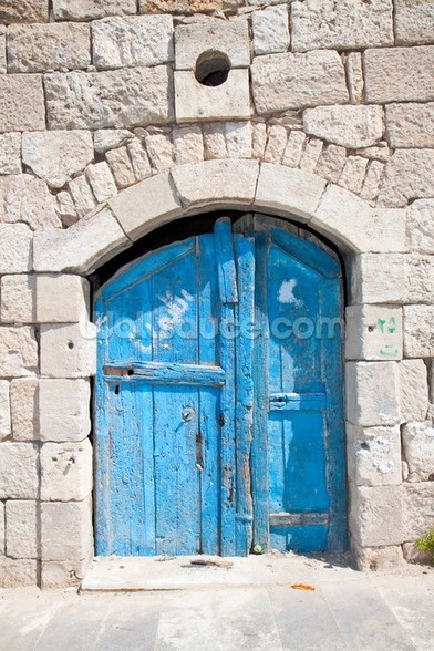 Wooden blue door in Madaba mural wallpaper