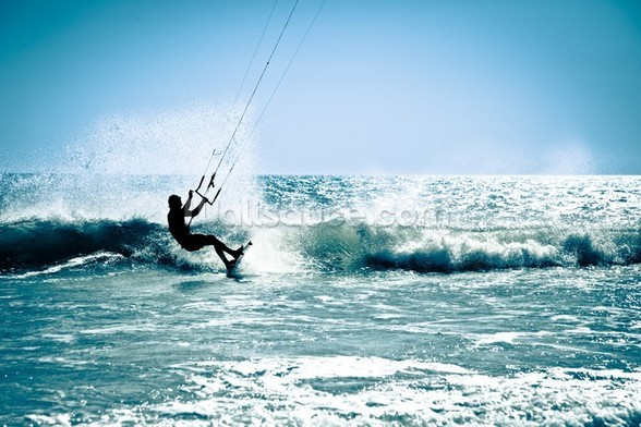 Kite surfing in waves. wall mural