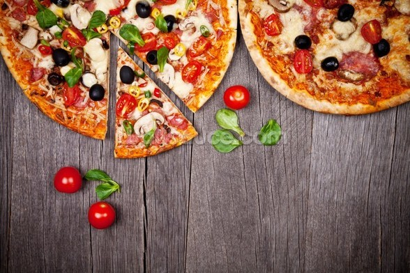 Delicious Italian Pizzas Served on Wooden Table wallpaper mural