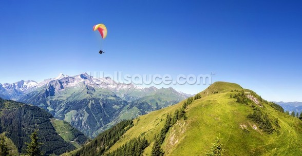 Mountain panorama with paraglider wall mural