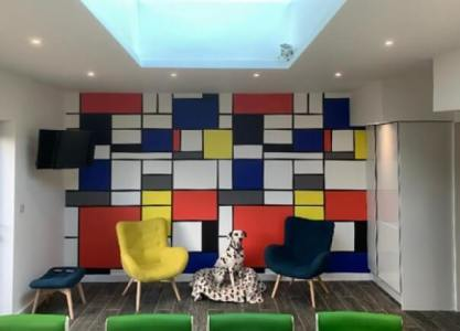 Mondrain wallpaper in large colourful lounge