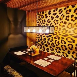 leopard print wallpaper in dining room