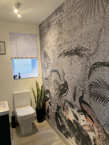 grey peacock wallpaper in bathroom