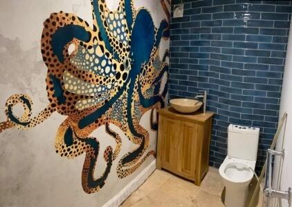 octopus mural in bathroom