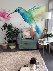 watercolour bird mural in living room