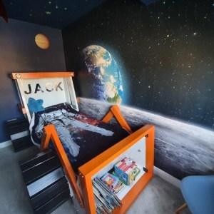 moon and earth mural in boy's bedroom