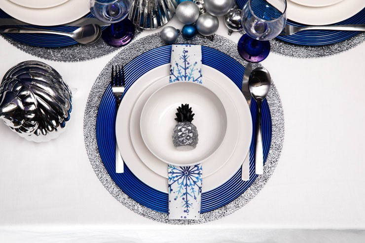 monochrome and navy dining set with white and blue plates and silver glittery placemats