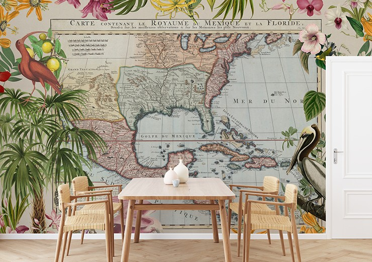 vintage and tropical caribbean map in dining room with wicker chairs