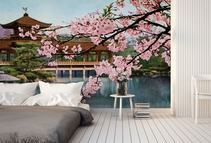 pink blossom tree branch with Japanese shrine behind it in minimalist bedroom