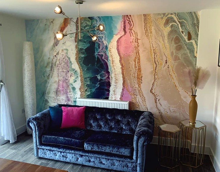 colourful geode wallpaper in navy and pink lounge