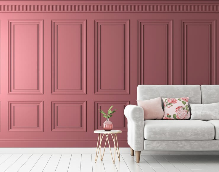 3d effect pink wood panel wallpaper in living room with pastel grey sofa and floral cushion