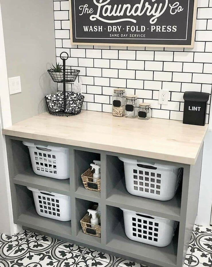 white baskets in grey and black laundry room
