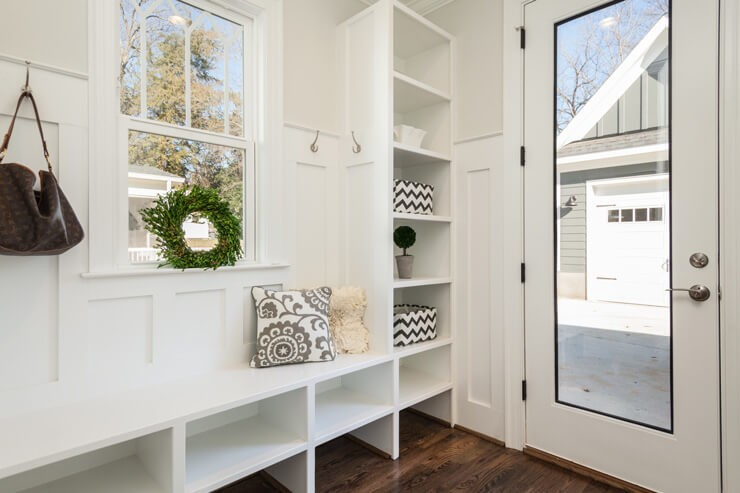 mudroom ideas for a white mudroom with black and white accessories