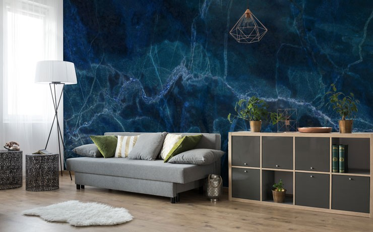 inky blue marble mural in large modern living room