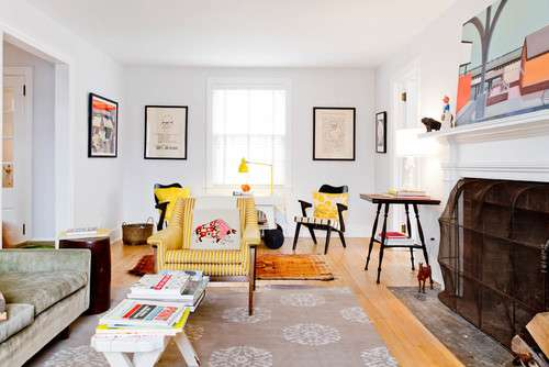 use rugs to create separate areas in a small room