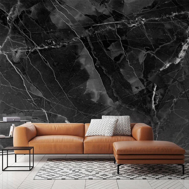 black marble with white flecks wallpaper in lounge with brown tan leather sofa