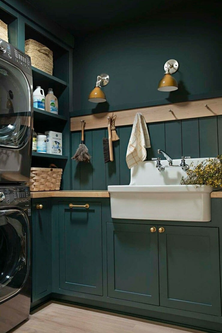 dark green cabinets in laundry room