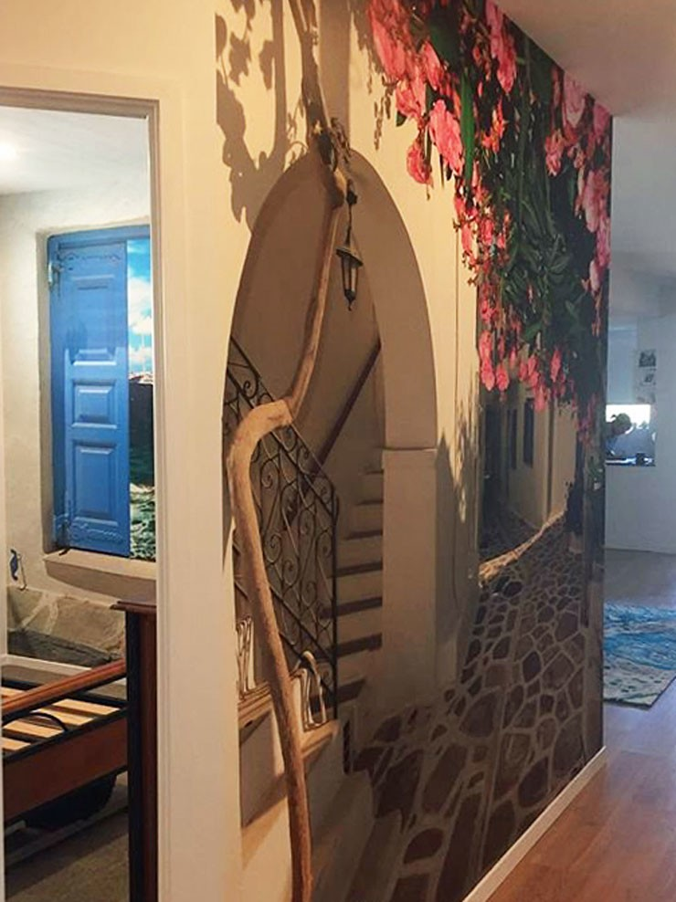 greek island white house with pink flowers wallpaper in homely hallway
