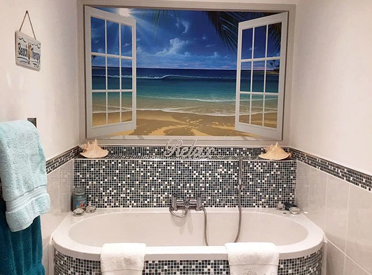 calming beach window view wallpaper in beach themed bathroom
