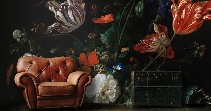 vintage dark flora painting wallpaper with brown leather chair