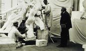 Auguste Rodin (1840-1917) in his Paris studio watching the construction of a sculpture, 1905 (b/w photo) wall mural thumbnail