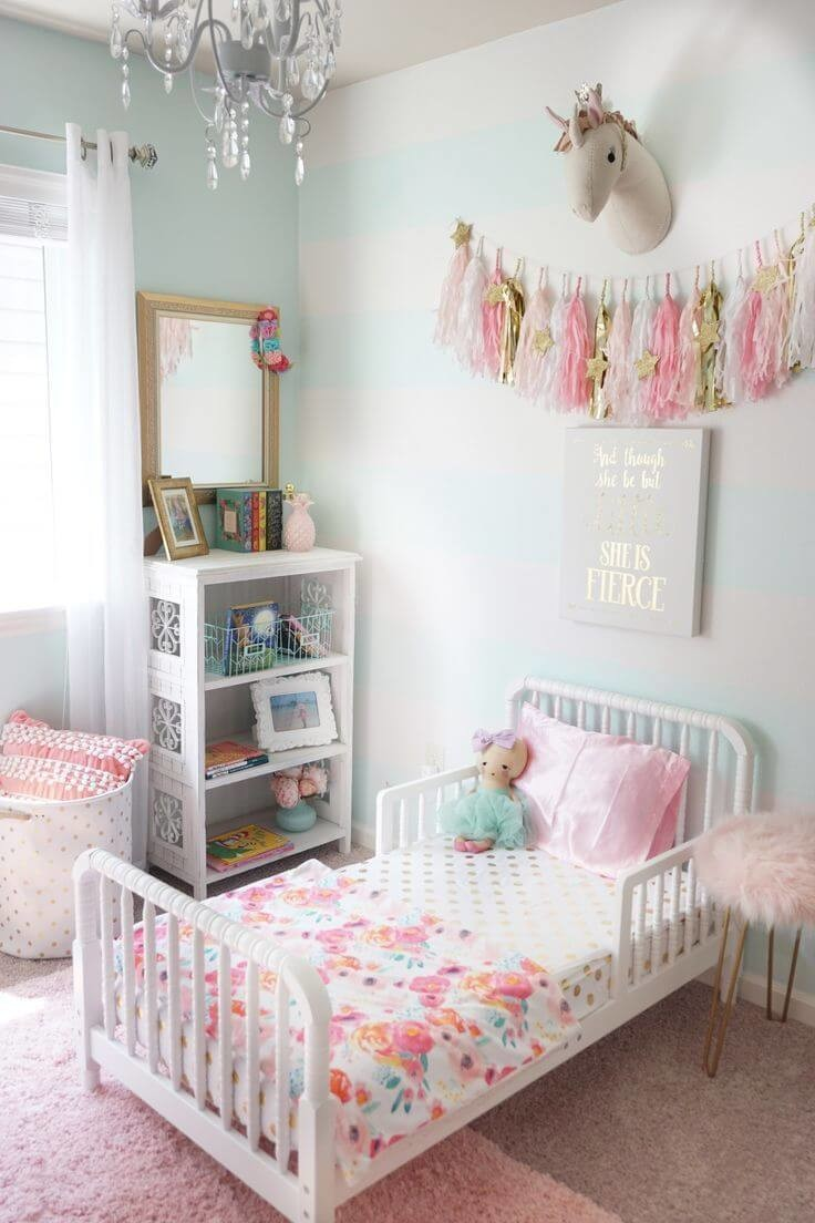 toddler room with white walls and white and pink accessories