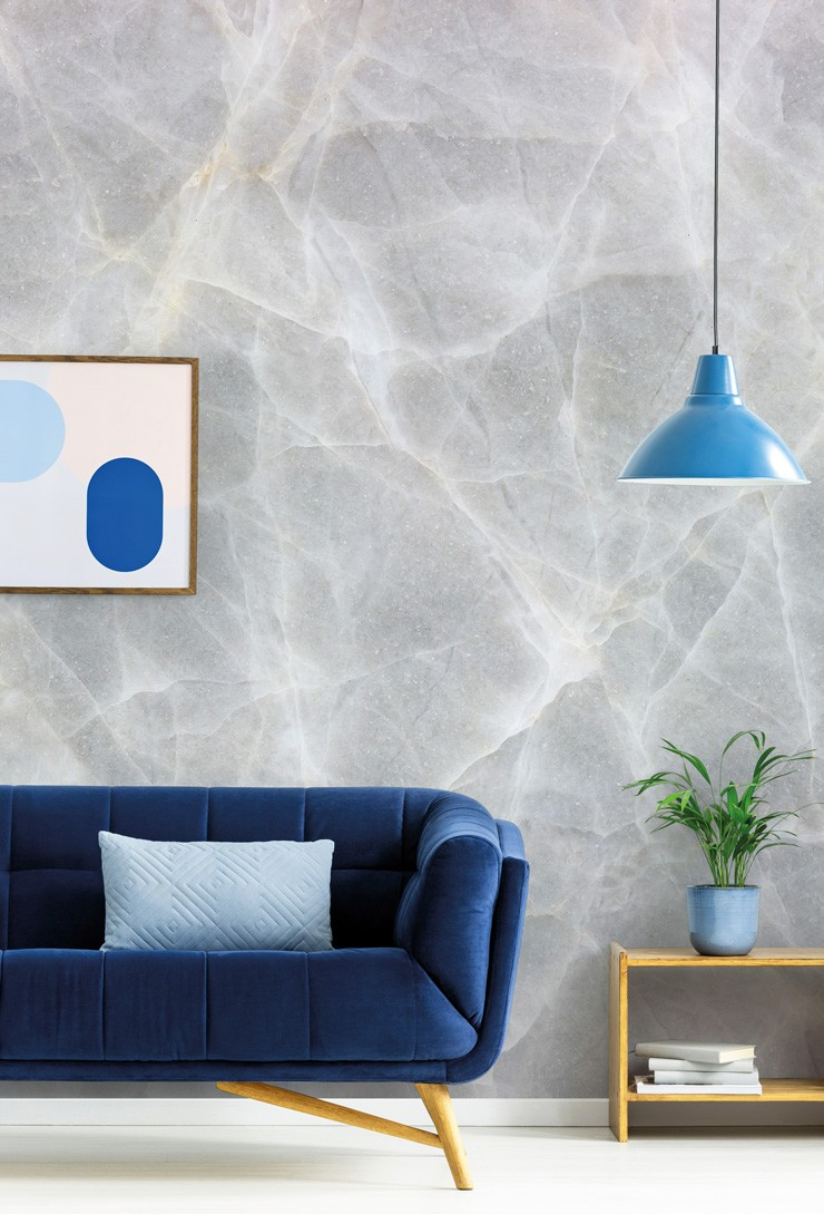 very pale grey marble wall mural in navy lounge