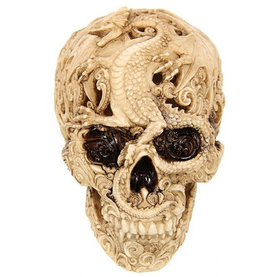 fake skull with dragon pattern carved into it