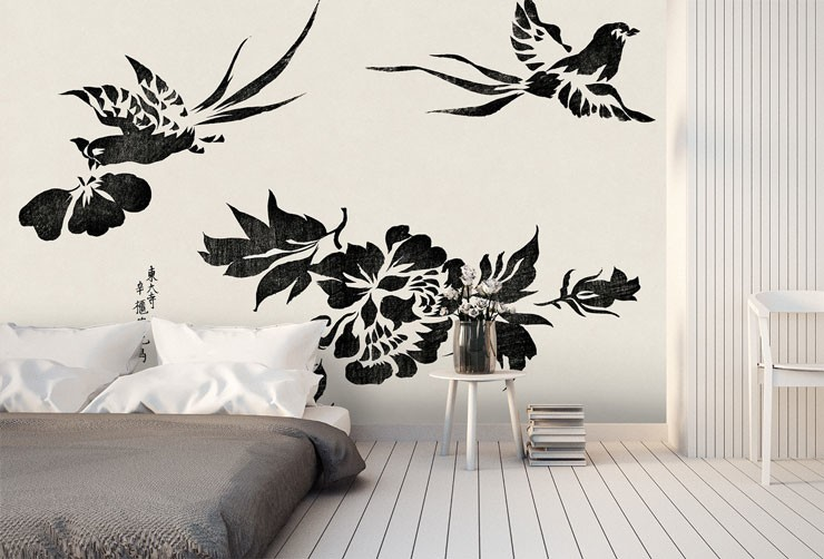 oriental black and white bird mural in white and grey bedroom with futon