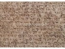 Ancient Assyrian clay tablet with cuneiform writing wall mural thumbnail