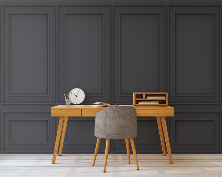 black wood panel wallpaper in trendy office with wooden desk and chair