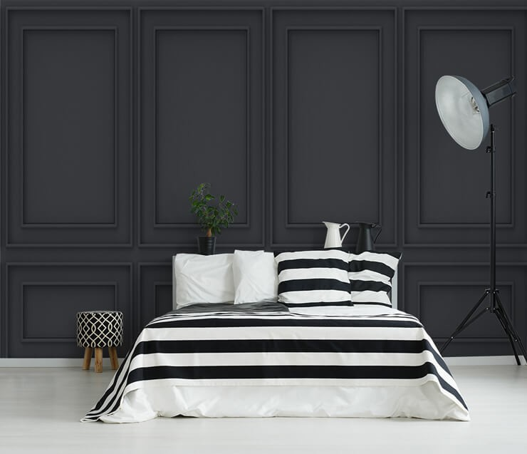 black panel effect wallpaper in bedroom with black and white striped bedding